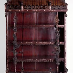 BEAUTIFUL CHINESE PAGODA FORM WOOD AND IVORY DISPLAY CABINET HITS $34,500 AT AUCTION HELD BY LELAND LITTLE AUCTION & ESTATE SALES, LTD.