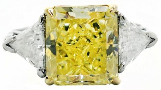 Lovely Cartier-certified 6.01-carat fancy intense yellow diamond ring (est. $100,000-$200,000).