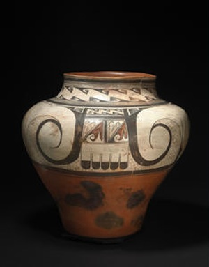 Hopi polychrome storage jar Nampeyo, decorated with three images of the eagle tail composition, marked by broad spirals and geometric complements, a neck band of repeated hooked wing motifs between multiple banding lines, an area of repair with minor restoration to the rim. height 16 3/4in, diameter 17 1/2in