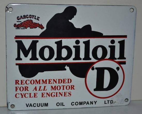 "Mobiloid single-sided porcelain sign with upper case ""D""; 9 inches by 11 inches rated 9."