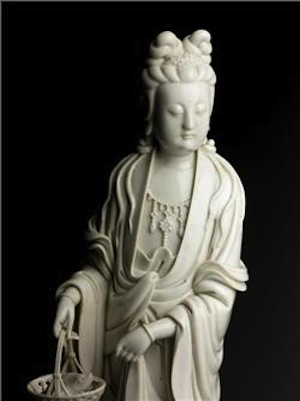 A Dehua Guanyin Holding A Basket With Fish 19th Century Estimate $6,000-8,000