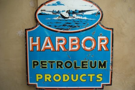 McCOLL-FRONTENAC PRODUCTS DOUBLE-SIDED PORCELAIN SIGN WITH 'RED INDIAN' LOGO MAKES $11,550 AT MATTHEWS AUCTIONS' CHECK THE OIL SALE