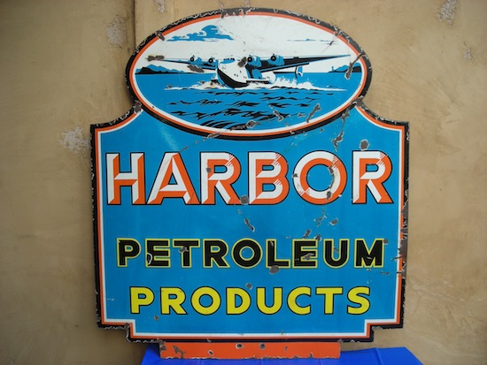 Harbor Petroleum Products double-sided porcelain die-cut sign with sea plane graphics, rated 7 and 6.5 ($8,250).