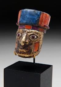 Incredible Nazca/Huari golden miniature head, est. $30,000-$50,000. Antiquities Saleroom image.