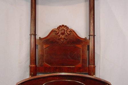 MAHOGANY HALF TESTER YOUTH-SIZE BED BRINGS $29,900 AND AN R.J. HORNER CARVED OAK 9-TUBE GRANDFATHER CLOCK HITS $21,850 AT STEVENS AUCTION