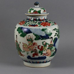 """Chinese Chongzheng (1628-1643) transitional """"Wucai boys"""" covered jar, 11½in, similar to an example that sold for HK$275,000 at Christie's May 2012 sale in Hong Kong. Est. $3,000-$5,000. Manatee Galleries image."""