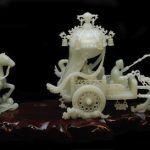 CHINESE HAND-CARVED WHITE JADE SCULPTURE DEPICTING A CHARIOT WITH HORSES AND RIDERS SOARS TO $40,120 AT ELITE DECORATIVE ARTS, JULY 13th
