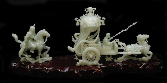 Chinese hand-carved white jade sculpture depicting a chariot with horses and riders ($40,120).