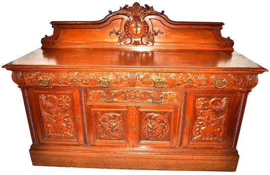 Magnificent Victorian Gothic tiger oak sideboard attributed to R.J. Horner, abundantly carved.