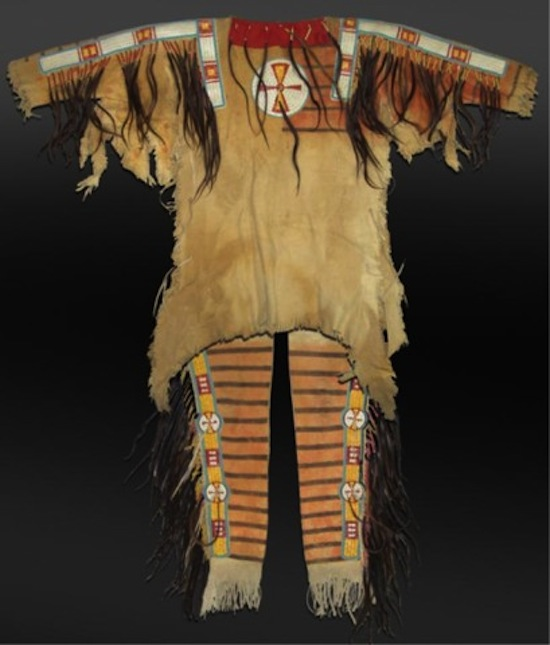 Mandan painted hide warshirt set with quilled strips and shields and human hair suspensions (est. $7,500-$15,000).