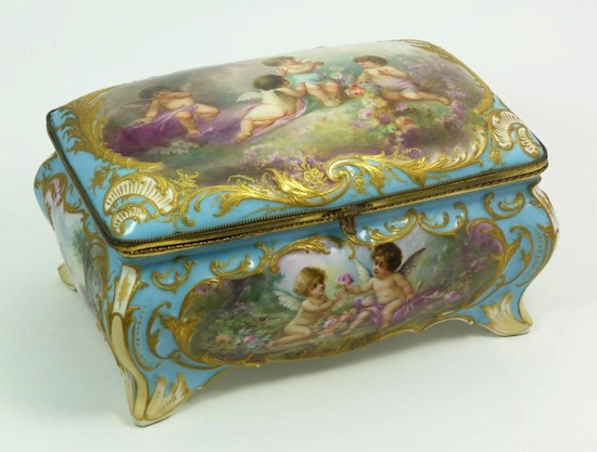 Antique Sevres French porcelain box depicting cherubs in forest scenes with flowers (est. $5,000-$7,000).