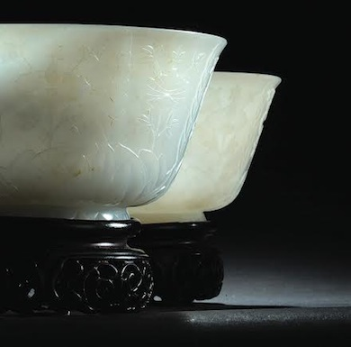 Lot 1046: PAIR OF NEPHRITE JADE LOTUS BOWLS, estimate: $60,000-$80,000.