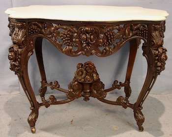 Rosewood rococo marble turtle-top parlor center table attributed to J. & J. W. Meeks ($33,350).