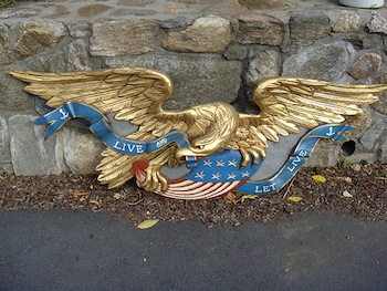 The top lot of the sale was this beautifully carved eagle with gold gilt trim, 72 inches long ($8,100).