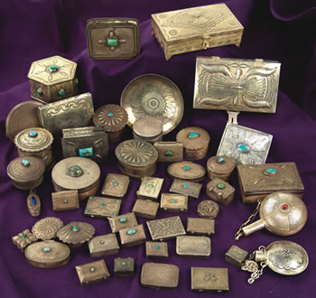 The top lot of the auction was a collection of 40 silver boxes, plus eight other items ($9,200).