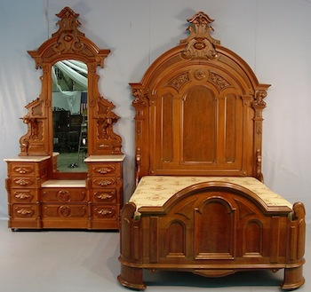 Gorgeous walnut Victorian three-piece bedroom suite, featuring a bed, dresser and washstand.