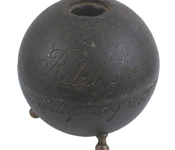 CONFEDERATE CANNONBALL FROM THE BATTLE OF GETTYSBURG MOUNTED ON THREE BRASS LEG FINIALS BRINGS $5,850 AT MOHAWK ARMS' AUCTION 71