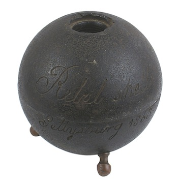Confederate cannonball from the Battle of Gettysburg (1863), mounted on three brass leg finials ($5,850).