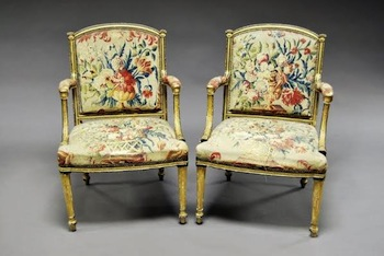 A pair of English George III giltwood armchairs by Thomas Chippendale
