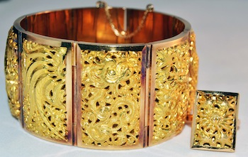 18kt gold bracelet having domed floral design in all eight sections appraised for $2,500, with matching companion ring appraised for $500.