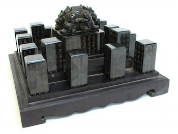 Rare antique Chinese carved Imperial seal box, fitted with 16 seals of green jade ($90,000).