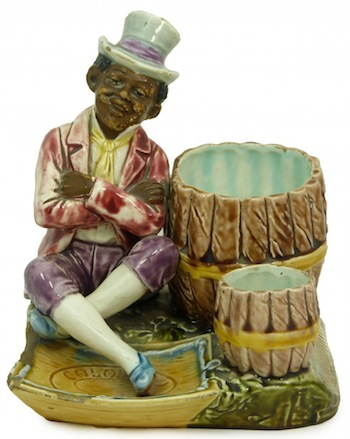 19th century Majolica Austrian cigarette set featuring a well-dressed black gentleman (est. $400-$600).