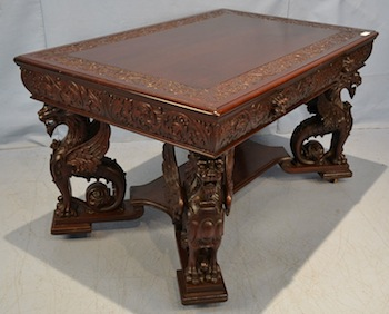 Mahogany partner's desk with race track top and finely carved griffins made by R. J. Horner.