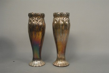 Exceedingly rare and monumental pair of Tiffany silver vases, Art Nouveau repousse ($33,600).