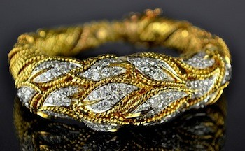 Gorgeous bracelet of 18k gold having six carats of diamonds with a Rolex watch inside ($6,847).