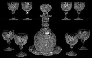 Cut glass decanter with underplate and eight matching wine glasses, in the Chrusanthemm pattern by Hawkes.