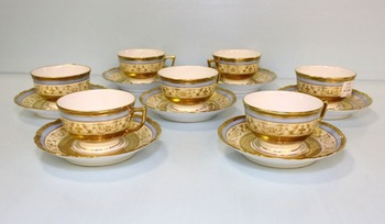 Set of eight (seven shown) Raynaud Limoges china cups and saucers in the Scheherazade pattern.