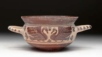 Corinthian (Greek) pottery kylix with images of facing swans and (on verso) a walking panther, circa 6th century CE, estimate $3,000-$5,000. Artemis Gallery image
