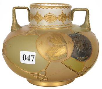 Unmarked Royal Flemish two-handled squat vase having a three-color segmented background with four decorative medallions.