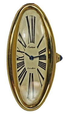 Cartier: An 18ct gold cased ladies wrist watch of curved elongated oval form. Sold for: £18,450