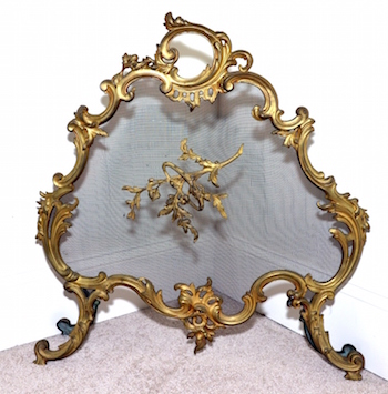 Ornate baroque metal fireside screen.
