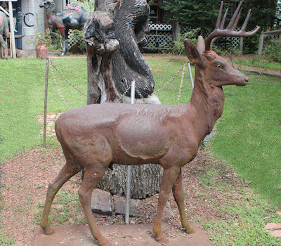 Life-size, impressive deer, made of iron by Moore circa 1900.