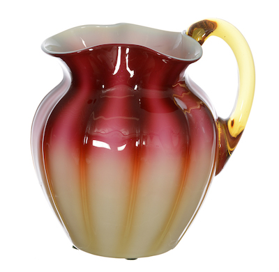 Very rare New England plated Amberina art glass water pitcher, having rich mahogany shading to pale green and well-defined ribs, 7 inches tall.