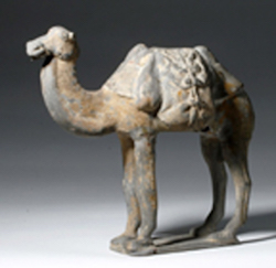 Chinese Tang Dynasty  (circa 618-907 CE) pottery figure of Bactrian camel with molded harness and saddlebags, ex Denver Art Museum, est. $4,000-$6,000