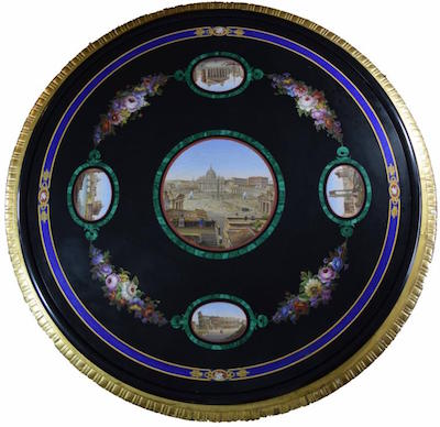 Beautiful micromosaic table made in Italy around 1850, circular in shape, made from black marble, with the top inlaid with semi-precious stones (est. $25,000-$45,000).