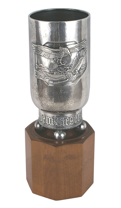 "Imperial German World War I fighter pilot's ""pokol"" (or silvered victory goblet), showing an embossed panel of two eagles in combat, 7 inches tall ($8,850)."