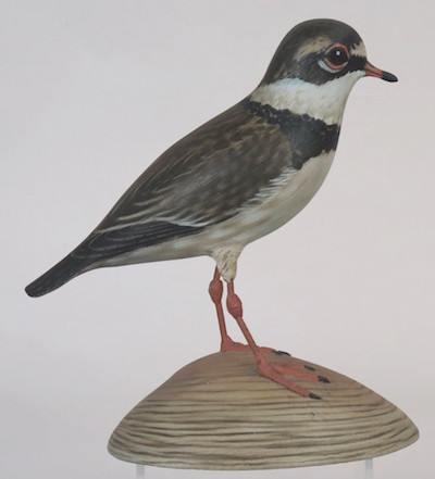 "Life-size, semi-palmated plover, a rare specie, in superb condition, mounted on a quahog shell base hand-signed, ""A. E. Crowell – Cape Cod"" ($17,250)."