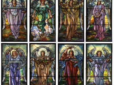 EXCEPTIONAL SET OF EIGHT GLASS WINDOWS, EXECUTED IN 1913 BY TIFFANY STUDIOS AND DEPICTING THE 8 BEATUTUDES OF JESUS, GAVELS FOR $356,950
