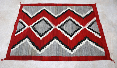 Gorgeous 60 inch by 50 inch Native American rug with multi-color design.