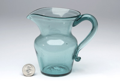 AN EARLY PATTERN MOLDED COVERED SUGAR BOWL AND A POCKET BOTTLE, BOTH MADE BY STIEGEL BETWEEN 1763 AND 1774, COMBINE FOR NEARLY $20,000