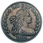DAVID LAWRENCE RARE COINS, ACTING ON BEHALF OF A PARTNER, DELL LOY HANSEN, PURCHASES AN 1804 DRAPED BUST DOLLAR COIN FOR $2.64 MILLION